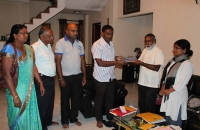Nuwara Eliya DIRC members meet a provincial council member to explain their activities and hand over a book on success stories